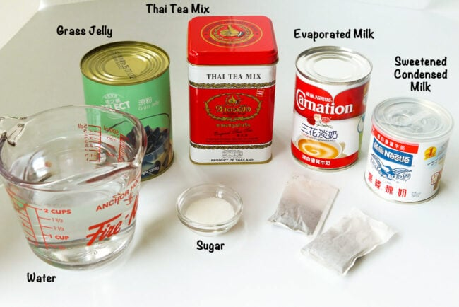 Labeled photo with ingredients for Thai Iced Milk Tea with Grass Jelly.