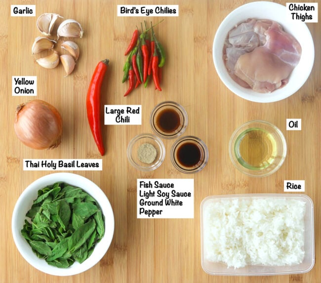 Labeled ingredients for Spicy Thai Basil Chicken Fried Rice on wooden board.