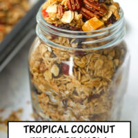"Front view of overfilled mason jar with granola, and scattered clusters around jar. Text overlay ""Tropical Pecan Coconut Granola"", ""Easy"", ""Customizable"", and ""Refined Sugar Free""."