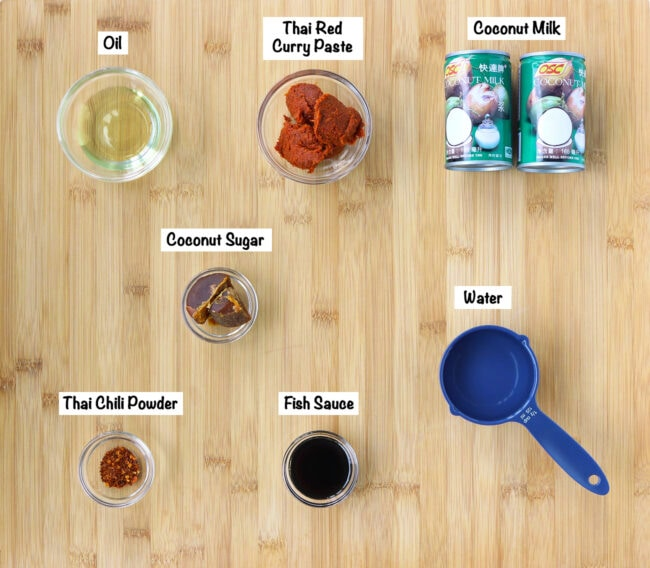 Choo Chee Curry Sauce ingredients on wooden board.