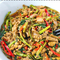 "Front view of bowl with lamb and veggies stir-fry. Text overlay ""Taiwanese Lamb & Water Spinach Stir-fry""."