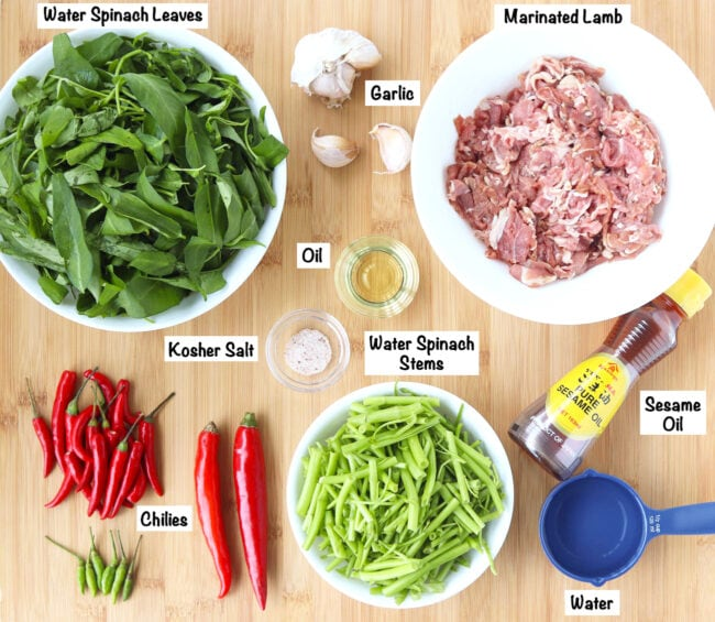 Labeled fresh ingredients for Taiwanese Lamb and Water Spinach Stir-fry on wooden board.