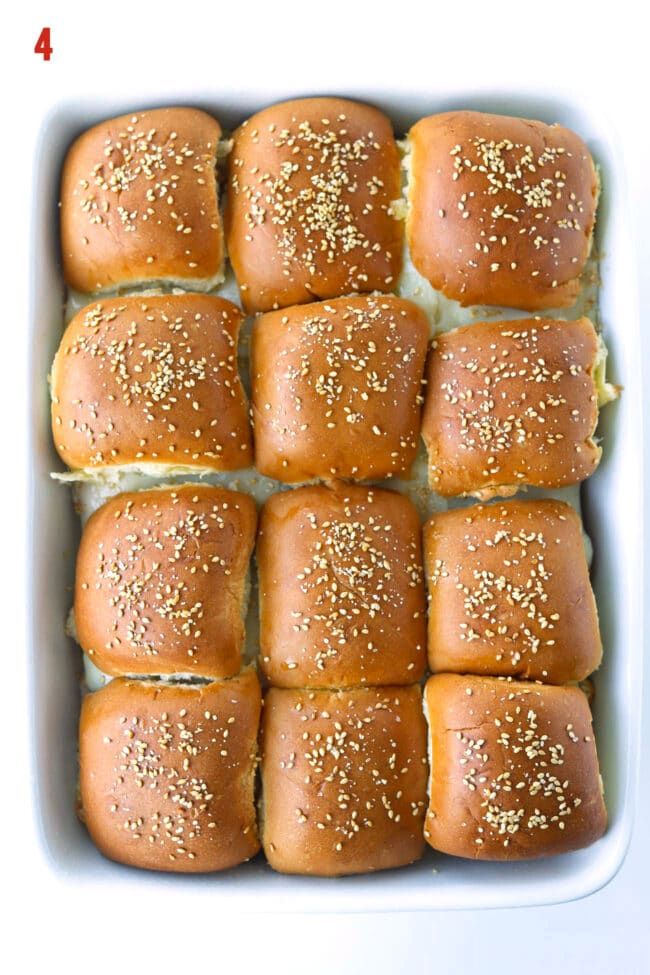 Top view of baked sliders in a large baking dish.