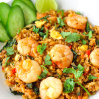 "Front view of spicy prawn fried rice on a plate. Text overlay ""Thai Roasted Chili Fried Rice with Prawns"" and ""thatspicychick.com""."