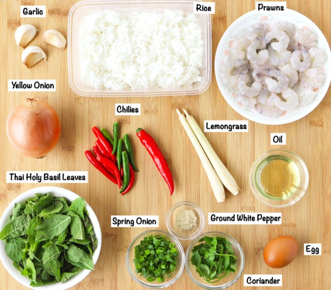 Labeled ingredients for Thai Roasted Chili Fried Rice with Prawns on a wooden board.