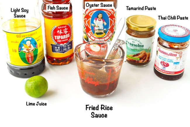 Labeled sauce ingredients for Thai Roasted Chili Fried Rice with Prawns on a white backdrop.