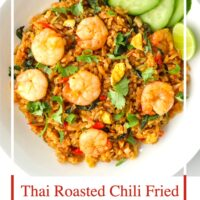 "Top view of a plate with spicy prawn fried rice. Text overlay ""Thai Roasted Chili Fried Rice with Prawns"" and ""thatspicychick.com""."