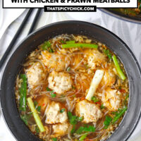 "Top view of bowl and Dutch oven with meatball noodle soup. Text overlay ""Thai Glass Noodle Soup with Chicken & Prawn Meatballs"" and ""thatspicychick.com""."