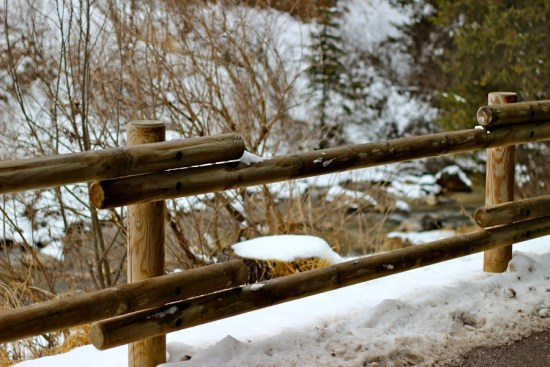 wooden fence at the waterside in canazei