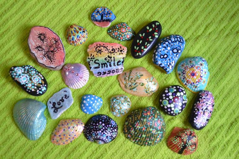 spreading kindness with hand painted rocks and shells the art of