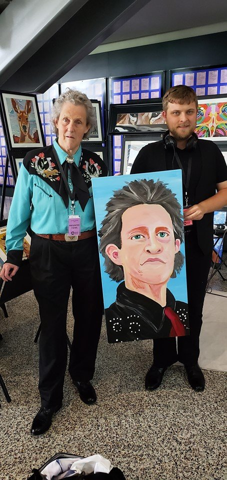 Joel Anderson with Temple Grandin Painting