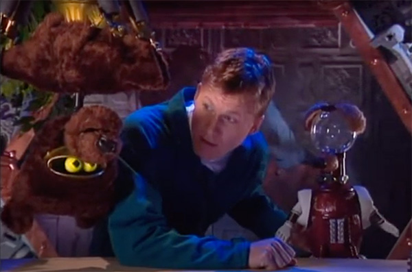crow t robot hanging upside down dressed as a bear with mike nelson and tom servo dressed as a dog