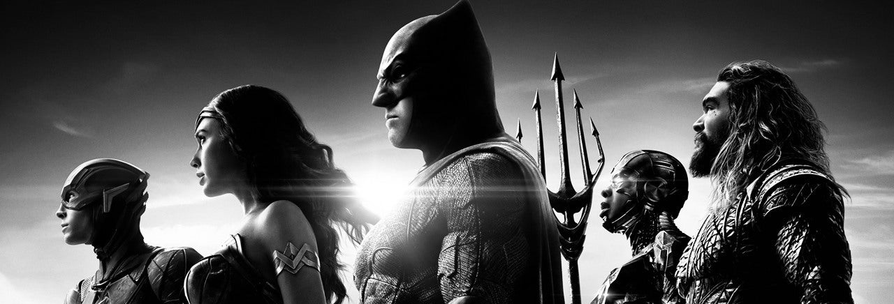 members of the Justice League in profile in front of a sunburst in black and white