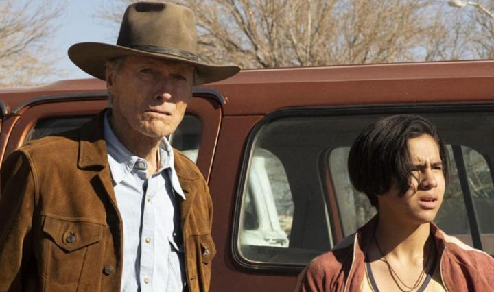 Clint Eastwood and Eduardo Minette stand in front of a pickup in 'Cry Macho'