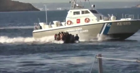 A photo of the Greek coastguard attacking refugees in a dinghy.