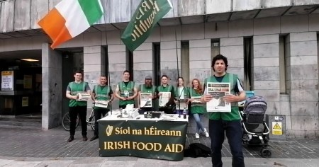 A photo of Síol na hÉireann members and their leader, Niall McConnell, outside Cork city library.