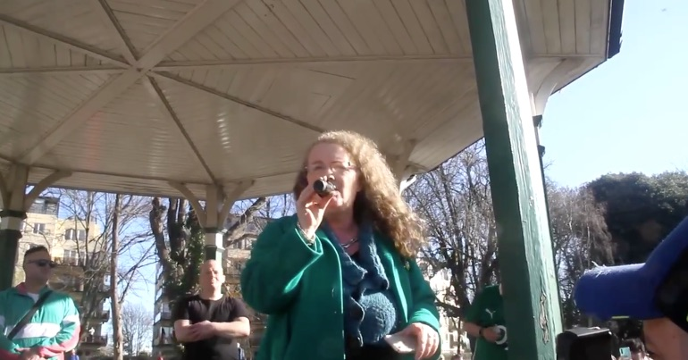 A photo of UCD Professor Dolores Cahill speaking at an anti-mask rally in Dublin on St. Patrick's Day.