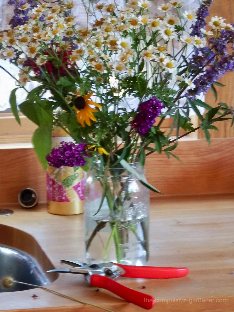 Garden floral bouquet of feverfew, buddlea, rudbeckia, vitex