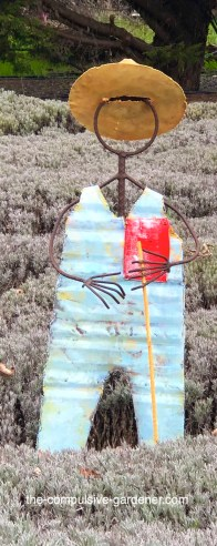 Metal sculpture of Farmer Grosso