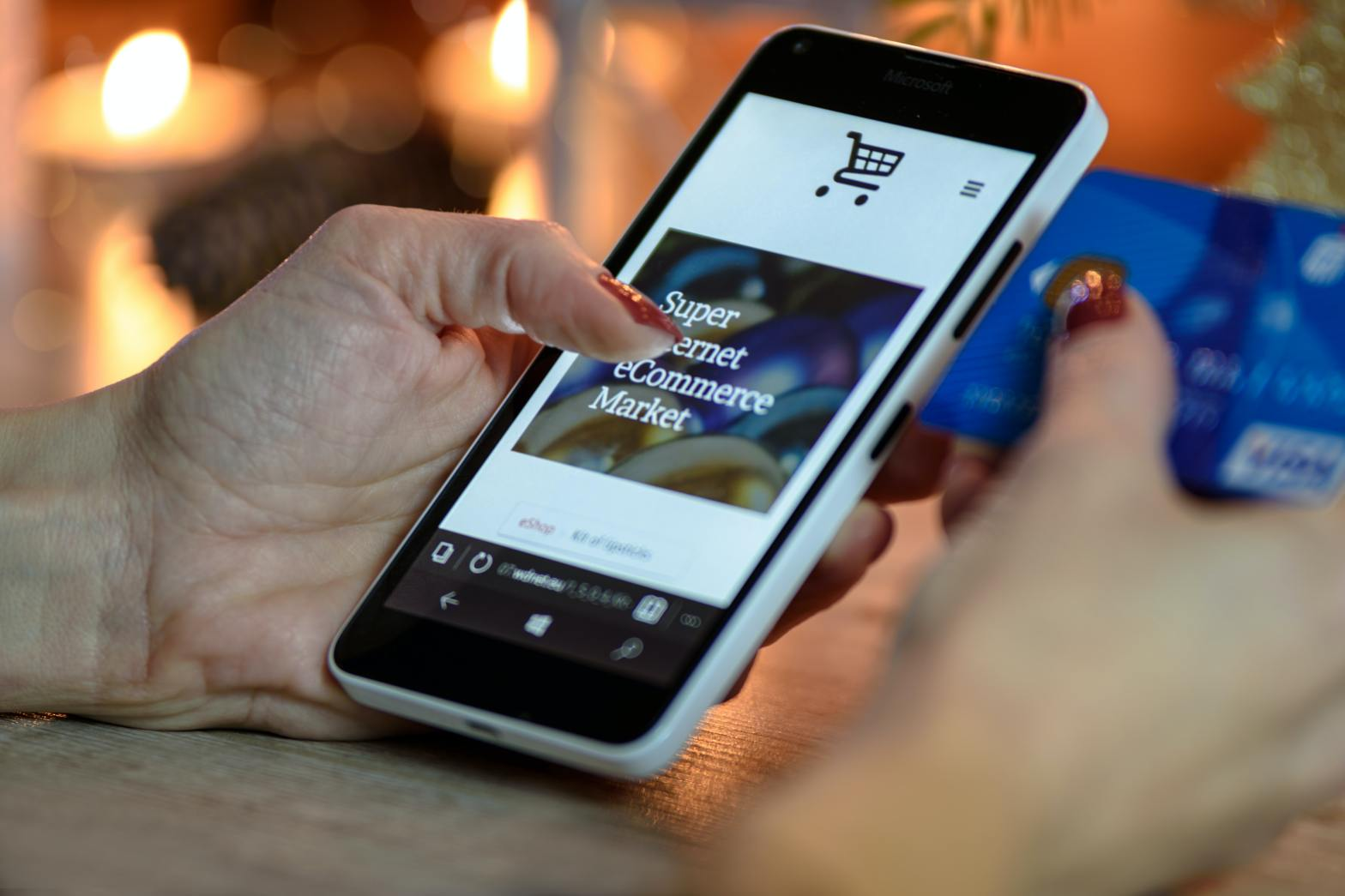 image of person shopping online with an iPhone