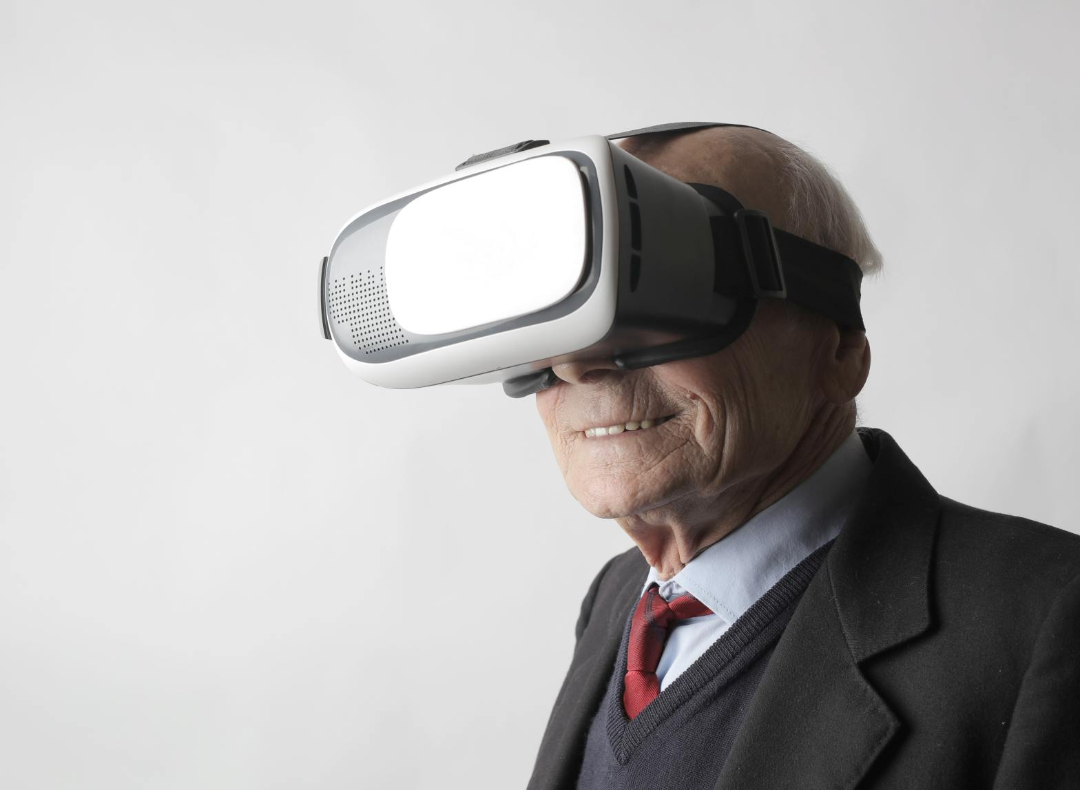 photo of a senior citizen wearing a vr headset
