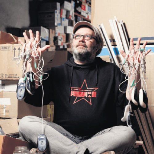 Man Black Sweater Holding Cords