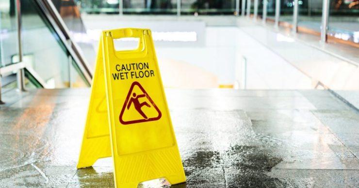 dow jones us stock market caution wet floor sign
