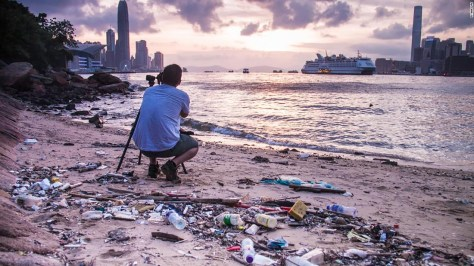 """Photo: Ryan Lai, Hong Kong: """"Piles of solid waste lie behind a perfectly-framed photograph of spectacular scenery."""""""