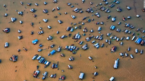 """Photo: Stuart Chape, Samoa: """"This aerial view of the Chong Kneas floating village on Tonle Sap lake, Cambodia, demonstrates just how threatened the great lake is from changing rainfall patterns and rising temperatures."""""""