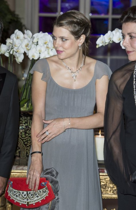 When Charlotte's Not Holding Her Chanel Bag, She's Showing Off Poppy Clutches
