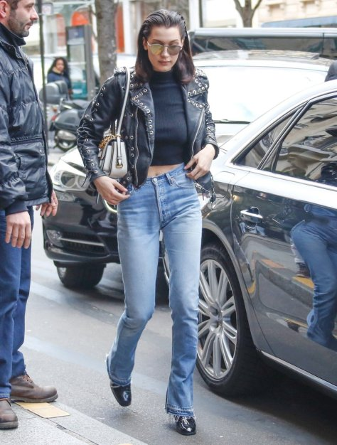 After the Miu Miu show, Bella hit the streets in distressed denim, a crop top, and a studded jacket. She finished her outfit with a Miu Miu bag and mirrored lenses.