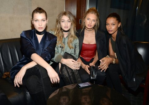 Gigi and Bella wore thick black chokers — Bella completing her Are You Am I style with a satin blazer and Gigi with a slick bomber — when they hit up the Yeezy Season 3 show. They hung out backstage with models Romee Strijd and Jasmine Tookes.