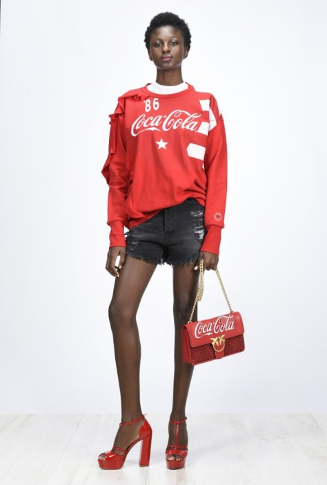 """Pinko teamed up with Coca-Cola on a line of wardrobe must haves for the Winter, including this ruffled jersey ($303) that's anything but your average crewneck. I can also picture wearing it with a leather miniskirt and sneakers in the Spring."" — Sarah Wasilak, editor, Fashion"