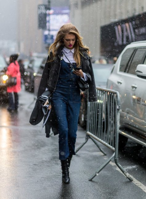 What's a little snow? Romee Strijd didn't let that stop her from wearing a blue denim jumpsuit outside the Jeremy Scott show during New York Fashion Week.