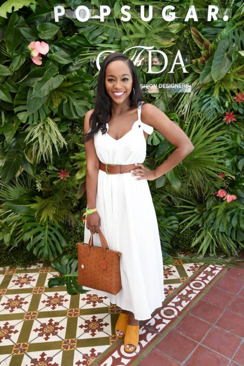 Aja Naomi King wore a breezy white dress, mules, and MCM bag to the POPSUGAR x CFDA brunch.