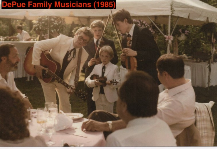 Family Musicians: Dad with guitar, three brothers in suits, holding fiddles, and singing.