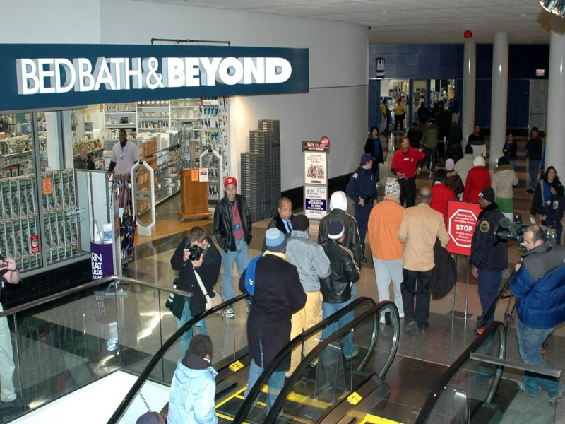 Black Friday deals, people queuing up for end of November shopping spree.