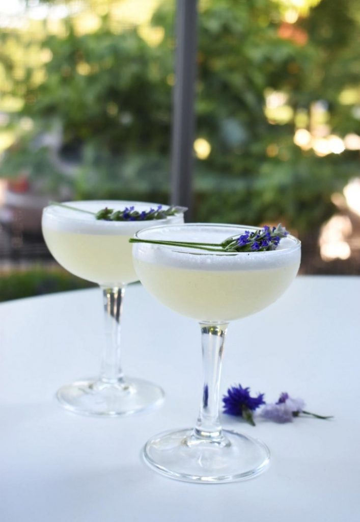 A cocktail with lavender flowers