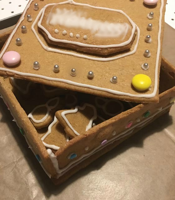 gingerbread biscuit box with iced gingerbread biscuits inside