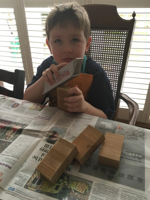 sanding wooden blocks