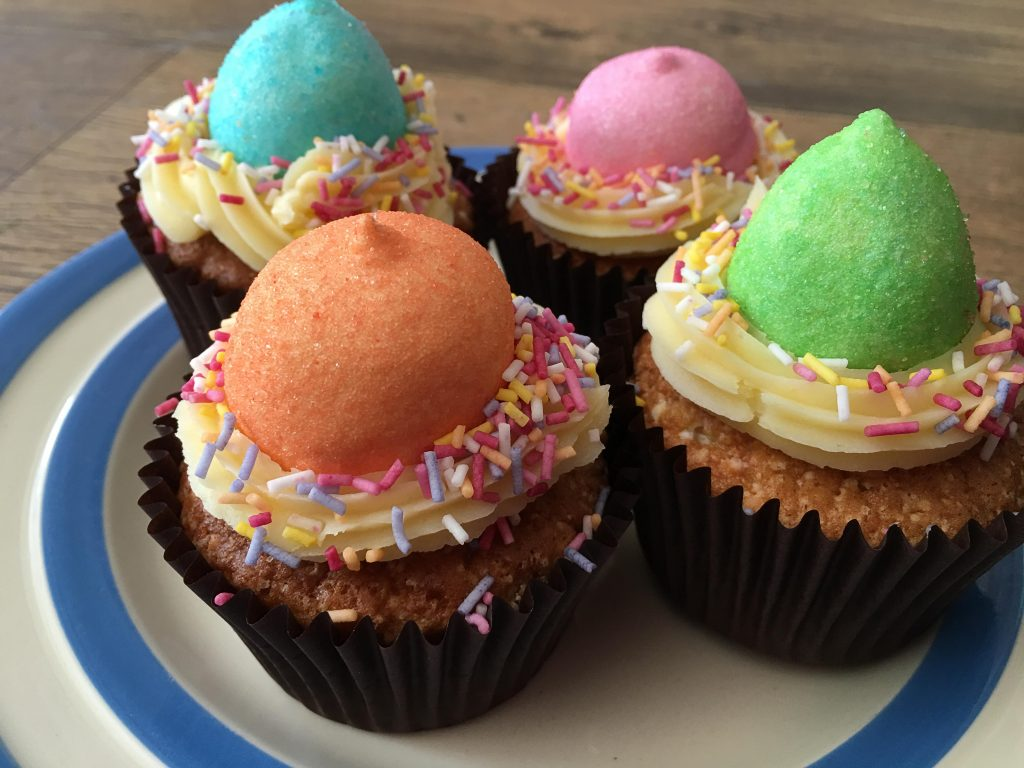 Colourful unicorn poop cupcakes