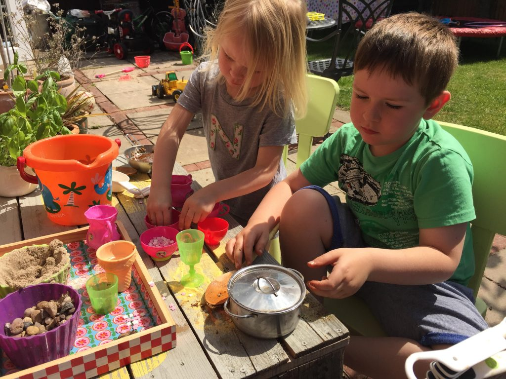 playing at the mud kitchen