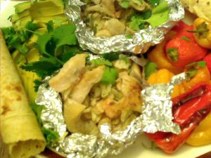Barbecued Mexican Shrimp Stuffed Red Snapper Packets, with avocado, Roasted Peppers, tortillas and cilantro