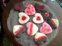 Glazed painted heart powdered sugar cookies with colored sugar