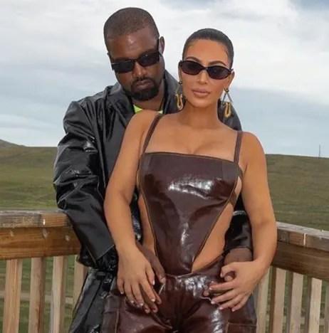 Kim Kardashian and Kanye West outside