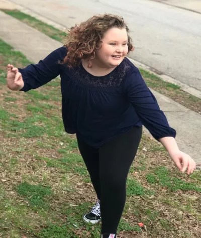 Alana Thompson Poses Outdoors