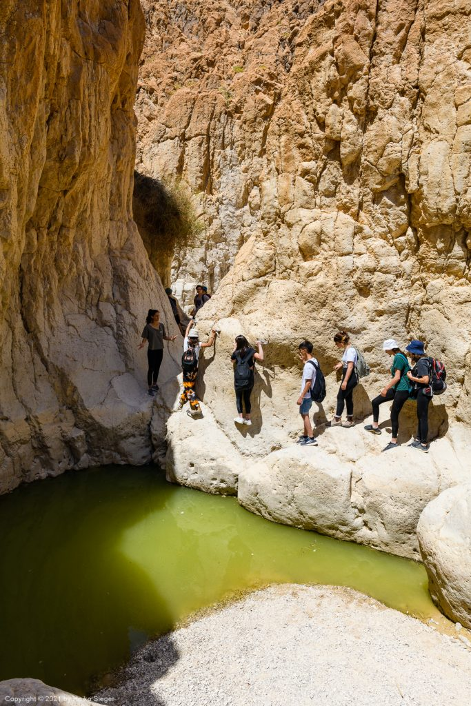 Dry canyon: climbing above a pothole filled with water