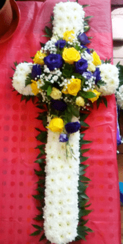 rose-lisianthus-funeral-cross-Funeral cross with yellow roses and purple lisianthus_funeral flowers The Little Flower Shop Florist.jpg TFS-min-min
