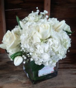 SMALL-FLORAL-ARRANGEMENT-white-hydrangea-roses-tulips-the-little-flower-shop-event-flowers-unleash-the-power-within-tony-robbins