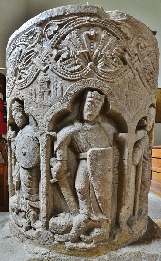 RIGHT The font in St Peter's Church, Southrop, in Gloucestershire, which depicts the Virtues conquering their antipodal vice.